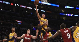 Mar 30, 2016; Los Angeles, CA, USA; Los Angeles Lakers guard Jordan Clarkson (6) shoots over Miami Heat guard Dwyane Wade (3) and the Heat defense during the second half at Staples Center. Mandatory Credit: Richard Mackson-USA TODAY Sports