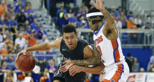 Feb 23, 2016; Gainesville, FL, USA; Vanderbilt Commodores guard Wade Baldwin IV (4) drives past Florida Gators guard Kasey Hill (0) during the first half of a basketball game at the Stephen C. O'Connell Center. Mandatory Credit: Reinhold Matay-USA TODAY Sports