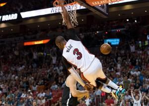 Mar 28, 2016; Miami, FL, USA; Miami Heat guard Dwyane Wade (3) dunks the ball past Brooklyn Nets guard Bojan Bogdanovic (44) during the second half at American Airlines Arena. The Heat won 110-99. Mandatory Credit: Steve Mitchell-USA TODAY Sports