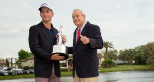 Mar 22, 2015; Orlando, FL, USA; Matt Every (left) celebrates winning the Arnold Palmer Invitational presented by MasterCard while holding the championship trophy and standing next to Arnold Palmer at Bay Hill Club & Lodge. Mandatory Credit: Kevin Liles-USA TODAY Sports