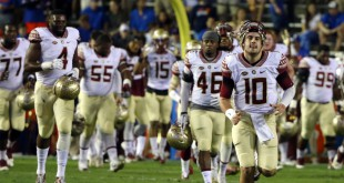Nov 28, 2015; Gainesville, FL, USA; Florida State Seminoles quarterback Sean Maguire (10) and teammates run off the field prior to the game against the Florida Gators at Ben Hill Griffin Stadium. Mandatory Credit: Kim Klement-USA TODAY Sports