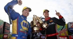 Mar 15, 2015; Gainesville, FL, USA; Funny car winner Ron Capps (left) and NHRA top fuel driver Spencer Massey celebrate together after winning the Gatornationals at Auto Plus Raceway at Gainesville. Mandatory Credit: Mark J. Rebilas-USA TODAY Sports