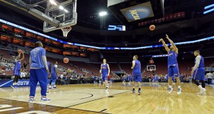 Mar 23, 2016; Louisville, KY, USA; Kansas Jayhawks forward Perry Ellis (34) shoots the ball during practice the day before the semifinals of the South regional of the NCAA Tournament at KFC YUM!. Mandatory Credit: Jamie Rhodes-USA TODAY Sports