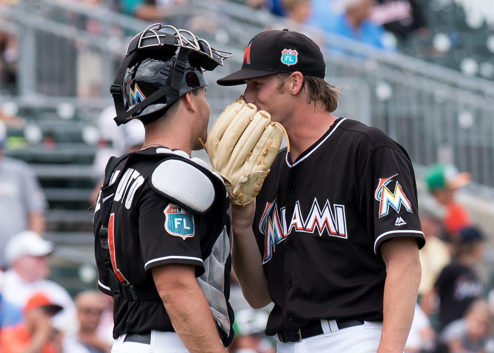 Mar 24, 2016; Jupiter, FL, USA; Miami Marlins starting pitcher Adam Conley (right) talks with Marlins catcher J.T. Realmuto (left) near the pitchers mound during a spring training game against the Minnesota Twins at Roger Dean Stadium. Mandatory Credit: Steve Mitchell-USA TODAY Sports