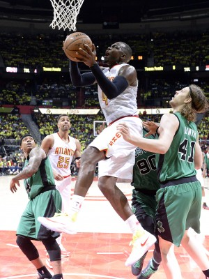 Apr 16, 2016; Atlanta, GA, USA; Atlanta Hawks forward Paul Millsap (4) drives to the basket against Boston Celtics center Kelly Olynyk (41) and forward Amir Johnson (90) during the second half in game one of the first round of the NBA Playoffs at Philips Arena. Mandatory Credit: John David Mercer-USA TODAY Sports