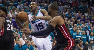 Apr 25, 2016; Charlotte, NC, USA; Charlotte Hornets guard Kemba Walker (15) shoots the ball against Miami Heat guard Dwayne Wade (3) in the second half in game four of the first round of the NBA Playoffs at Time Warner Cable Arena. The Hornets defeated the Heat 89-85. Mandatory Credit: Jeremy Brevard-USA TODAY Sports