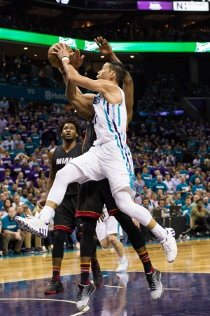 Apr 25, 2016; Charlotte, NC, USA; Charlotte Hornets guard Jeremy Lin (7) goes up for a shot against the Miami Heat during the second half in game four of the first round of the NBA Playoffs at Time Warner Cable Arena. The Hornets defeated the Heat 89-85. Mandatory Credit: Jeremy Brevard-USA TODAY Sports