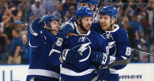 Apr 13, 2016; Tampa, FL, USA; Tampa Bay Lightning right wing Nikita Kucherov (86) is congratulated by  defenseman Nikita Nesterov (89), center Tyler Johnson (9) after he scored the against he Detroit Red Wings during the first period in game one of the first round of the 2016 Stanley Cup Playoffs at Amalie Arena. Mandatory Credit: Kim Klement-USA TODAY Sports