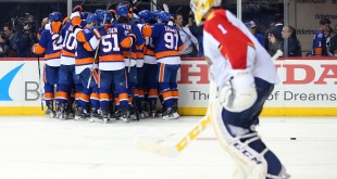 Apr 17, 2016; Brooklyn, NY, USA; The New York Islanders celebrate after scoring the game winning goal in front of Florida Panthers goalie Roberto Luongo (1) during the overtime period of game three of the first round of the 2016 Stanley Cup Playoffs at Barclays Center. The Islanders defeated the Panthers 4-3 in overtime to take a two games to one lead in the best of seven series. Mandatory Credit: Brad Penner-USA TODAY Sports