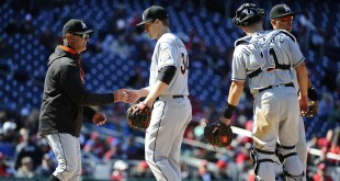 Apr 10, 2016; Washington, DC, USA; Miami Marlins starting pitcher Tom Koehler (34) is removed from the game by Miami Marlins manager Don Mattingly (8) during the seventh inning at Nationals Park. Mandatory Credit: Brad Mills-USA TODAY Sports