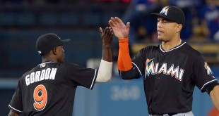 Apr 26, 2016; Los Angeles, CA, USA; Miami Marlins second baseman Dee Gordon (9) greets right fielder Giancarlo Stanton (27) after defeating the Los Angeles Dodgers 6-3 at Dodger Stadium. Mandatory Credit: Jayne Kamin-Oncea-USA TODAY Sports