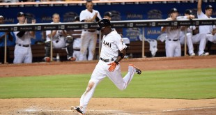 Apr 5, 2016; Miami, FL, USA; Miami Marlins second baseman Dee Gordon (9) scores a run during the sixth inning against the Detroit Tigers at Marlins Park. Mandatory Credit: Steve Mitchell-USA TODAY Sports