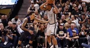 Apr 17, 2016; San Antonio, TX, USA; San Antonio Spurs small forward Kawhi Leonard (2) is defended by Memphis Grizzlies small forward Matt Barnes (22) during the second half in game one of the first round of the NBA Playoffs at AT&T Center. Mandatory Credit: Soobum Im-USA TODAY Sports