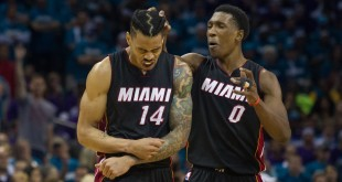 Apr 25, 2016; Charlotte, NC, USA; Miami Heat guard Josh Richardson (0) celebrates with guard Gerald Green (14) after a score in the second half against the Charlotte Hornets in game four of the first round of the NBA Playoffs at Time Warner Cable Arena. The Hornets defeated the Heat 89-85. Mandatory Credit: Jeremy Brevard-USA TODAY Sports