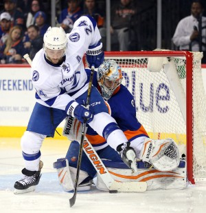 Apr 4, 2016; Brooklyn, NY, USA; Tampa Bay Lightning right wing Ryan Callahan (24) plays the puck against New York Islanders goalie Thomas Greiss (1) during the third period at Barclays Center. Mandatory Credit: Brad Penner-USA TODAY Sports