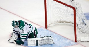 Apr 9, 2015; Boston, MA, USA; University of North Dakota goalie Zane McIntyre  (31) reacts after giving up a goal to Boston University during the second period in a semifinal game in the men's Frozen Four college ice hockey tournament at TD Garden. Mandatory Credit: Greg M. Cooper-USA TODAY Sports