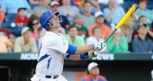 Jun 13, 2015; Omaha, NE, USA;  Florida Gators infielder Peter Alonso (20) drives in a run with a sacrifice fly against the Miami Hurricanes in the fourth inning  in the 2015 College World Series at TD Ameritrade Park. Mandatory Credit: Steven Branscombe-USA TODAY Sports