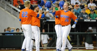 Jun 17, 2015; Omaha, NE, USA; Florida Gators infielder Peter Alonso (20) celebrates with teammates after hitting a home run in the seventh inning against the Miami Hurricanes  in the 2015 College World Series at TD Ameritrade Park. The Gators won 10-2. Mandatory Credit: Steven Branscombe-USA TODAY Sports