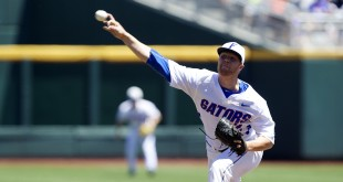 Jun 19, 2015; Omaha, NE, USA; Florida Gators pitcher Logan Shore (32) throws against Virginia Cavaliers in the first inning in the 2015 College World Series at TD Ameritrade Park. Mandatory Credit: Bruce Thorson-USA TODAY Sports