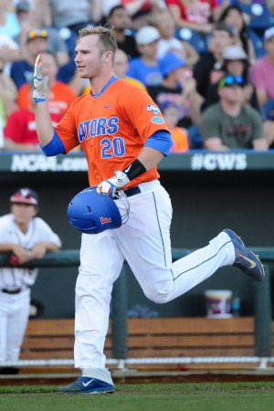 un 20, 2015; Omaha, NE, USA; Florida Gators infielder Peter Alonso (20) signals his team after hitting a home run in the second inning against the Virginia Cavaliers in the 2015 College World Series at TD Ameritrade Park. Mandatory Credit: Steven Branscombe-USA TODAY Sports