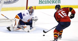 Nov 27, 2015; Sunrise, FL, USA; Florida Panthers center Aleksander Barkov (16) scores the game winning goal past New York Islanders goalie Jaroslav Halak (41). The Panthers won 3-2 in a shootout at BB&T Center. Mandatory Credit: Robert Mayer-USA TODAY Sports