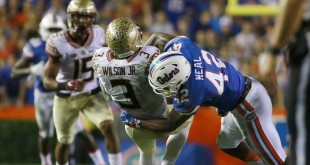 Nov 28, 2015; Gainesville, FL, USA; Florida Gators defensive back Keanu Neal (42) tackles Florida State Seminoles wide receiver Jesus Wilson (3) during the second half at Ben Hill Griffin Stadium. Florida State defeated Florida 27-2. Mandatory Credit: Kim Klement-USA TODAY Sports