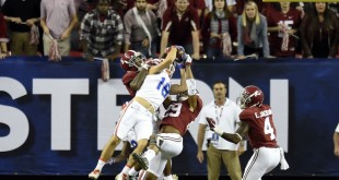 Dec 5, 2015; Atlanta, GA, USA; Florida Gators wide receiver C.J. Worton (18) catches a 46 yard touchdown pass between Alabama Crimson Tide defensive back Minkah Fitzpatrick (29) and Cyrus Jones (5) during the fourth quarter in the 2015 SEC Championship Game at the Georgia Dome. Mandatory Credit: Dale Zanine-USA TODAY Sports