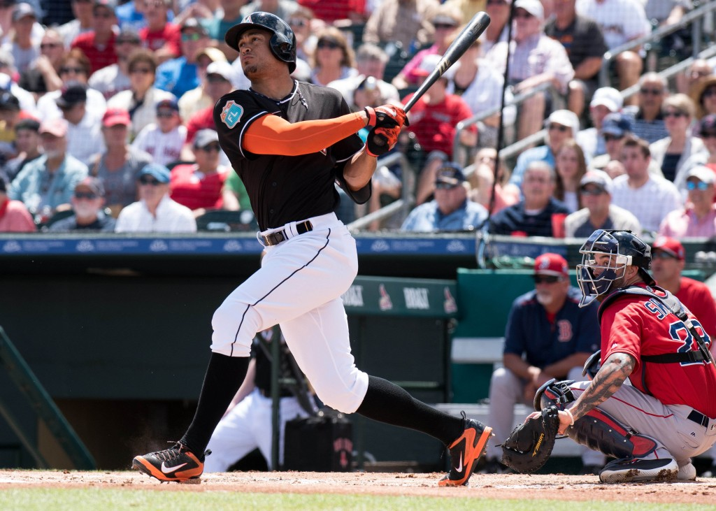 Mar 22, 2016; Jupiter, FL, USA; Miami Marlins right fielder Giancarlo Stanton (27) at bat against the Boston Red Sox during a spring training game at Roger Dean Stadium. Mandatory Credit: Steve Mitchell-USA TODAY Sports
