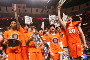 Mar 27, 2016; Chicago, IL, USA; Syracuse Orange players celebrate after defeating the Virginia Cavaliers in the championship game of the midwest regional of the NCAA Tournament at the United Center. Mandatory Credit: Dennis Wierzbicki-USA TODAY Sports