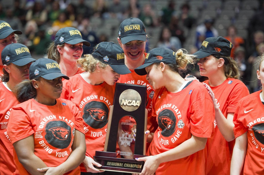 Mar 28, 2016; Dallas, TX, USA; The Oregon State Beavers celebrate the win over the Baylor Bears in the finals of the Dallas regional of the women's NCAA Tournament at American Airlines Center. The Beavers defeated the Bears 60-57. Mandatory Credit: Jerome Miron-USA TODAY Sports