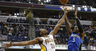 Mar 31, 2016; Indianapolis, IN, USA; Orlando Magic guard Victor Oladipo (3) shoots the ball over Indiana Pacers center Ian Mahinmi (28) during the second half at Bankers Life Fieldhouse. Mandatory Credit: Brian Spurlock-USA TODAY Sports