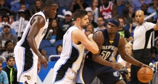 Apr 3, 2016; Orlando, FL, USA; Memphis Grizzlies forward Zach Randolph (50) dribbles in the fourth quarter as Orlando Magic center Nikola Vucevic (9) and guard Victor Oladipo (5) defends at Amway Center. The Orlando Magic won 119-107. Mandatory Credit: Logan Bowles-USA TODAY Sports