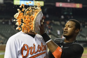 Apr 4, 2016; Baltimore, MD, USA; Baltimore Orioles center fielder Adam Jones (10) pies catcher Matt Wieters (32) after his walk off hit against the Minnesota Twins at Oriole Park at Camden Yards. Baltimore Orioles defeated Minnesota Twins 3-2. Mandatory Credit: Tommy Gilligan-USA TODAY Sports