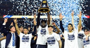 Apr 4, 2016; Houston, TX, USA; Villanova Wildcats forward Daniel Ochefu hoists the national championship trophy with teammates after defeating the North Carolina Tar Heels in the championship game of the 2016 NCAA Men's Final Four at NRG Stadium. Mandatory Credit: Robert Deutsch-USA TODAY Sports