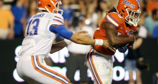 Apr 8, 2016; Gainesville, FL, USA; Florida Gators quarterback Feleipe Franks (13) hands the ball off to Florida Gators running back Jordan Scarlett (25) in the fourth quarter during the Orange and Blue game at Ben Hill Griffin Stadium. Blue won 38-6. Mandatory Credit: Logan Bowles-USA TODAY Sports