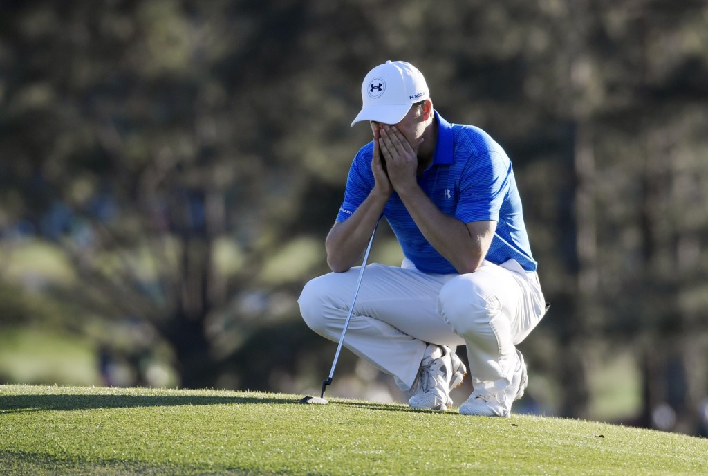 Apr 10, 2016; Augusta, GA, USA; Jordan Spieth reacts as he waits to putt on the 18th green during the final round of the 2016 The Masters golf tournament at Augusta National Golf Club. Mandatory Credit: Michael Madrid-USA TODAY Sports