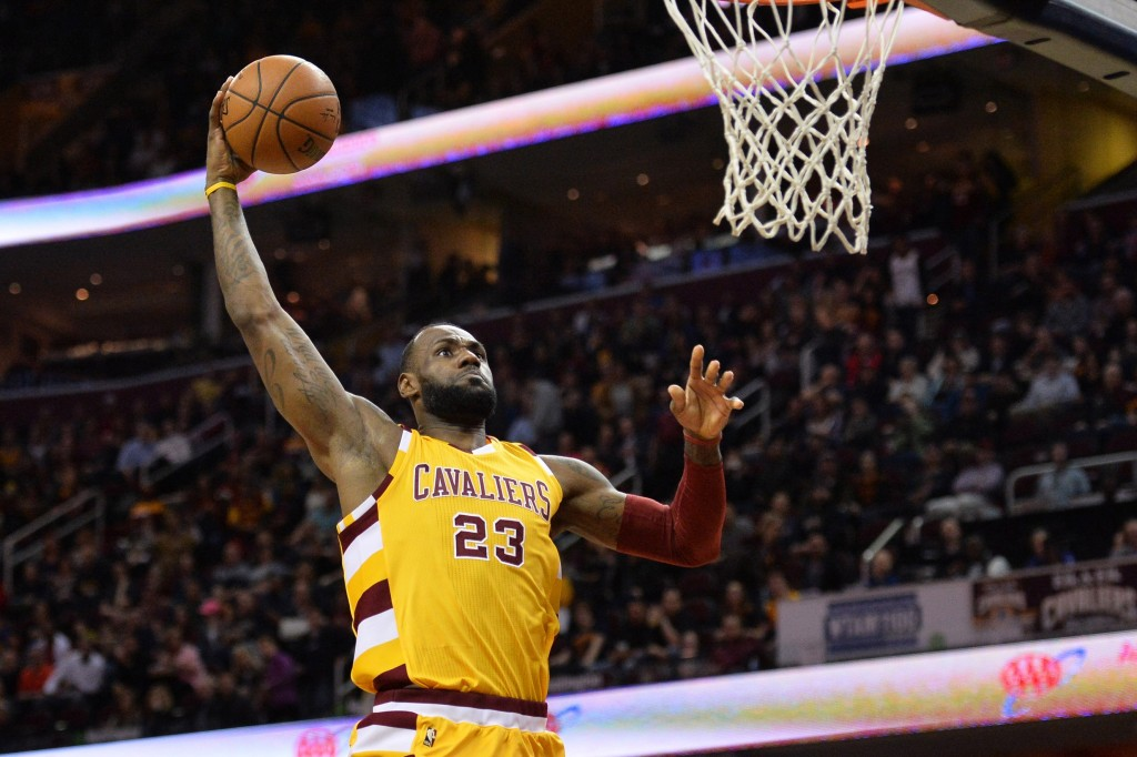 Apr 11, 2016; Cleveland, OH, USA; Cleveland Cavaliers forward LeBron James (23) slam dunks against the Atlanta Hawks during the first quarter at Quicken Loans Arena. Mandatory Credit: Ken Blaze-USA TODAY Sports