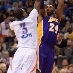 Apr 11, 2016; Oklahoma City, OK, USA; Los Angeles Lakers forward Kobe Bryant (24) shoots the ball over Oklahoma City Thunder guard Dion Waiters (3) during the first quarter at Chesapeake Energy Arena. Mandatory Credit: Mark D. Smith-USA TODAY Sports
