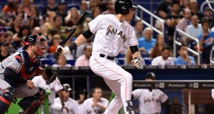 Apr 15, 2016; Miami, FL, USA; Miami Marlins left fielder Christian Yelich (right) connects for a base hit during the first inning against the Atlanta Braves at Marlins Park. Mandatory Credit: Steve Mitchell-USA TODAY Sports