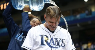 Apr 16, 2016; St. Petersburg, FL, USA; Tampa Bay Rays left fielder Brandon Guyer (5) has water poured over him by starting pitcher Chris Archer (22) after defeating the Chicago White Sox at Tropicana Field. Mandatory Credit: Kim Klement-USA TODAY Sports