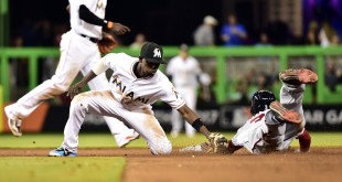 Apr 18, 2016; Miami, FL, USA; Miami Marlins second baseman Dee Gordon (9) tags out Washington Nationals center fielder Michael Taylor (3) at second base during the seventh inning of a game against the at Marlins Park. Mandatory Credit: Steve Mitchell-USA TODAY Sports