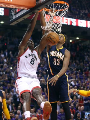 Apr 18, 2016; Toronto, Ontario, CAN; Toronto Raptors center Bismack Biyombo (8) dunks the ball against Indiana Pacers forward Myles Turner (33) in game two of the first round of the 2016 NBA Playoffs at Air Canada Centre. The Raptors beat the Pacers 98-87. Mandatory Credit: Tom Szczerbowski-USA TODAY Sports
