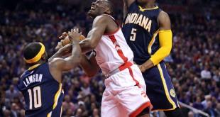 Apr 18, 2016; Toronto, Ontario, CAN; Toronto Raptors center Bismack Biyombo (8) is fouled by Indiana Pacers guard Ty Lawson (10) in game two of the first round of the 2016 NBA Playoffs at Air Canada Centre. The Raptors beat the Pacers 98-87. Mandatory Credit: Tom Szczerbowski-USA TODAY Sports