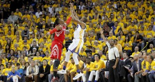 Apr 18, 2016; Oakland, CA, USA; Golden State Warriors guard Andre Iguodala (9) attempts a shot over Houston Rockets center Dwight Howard (12) in the second quarter in game two of the first round of the NBA Playoffs at Oracle Arena. Mandatory Credit: Cary Edmondson-USA TODAY Sports
