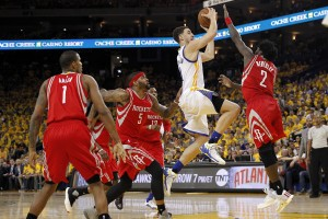 Apr 18, 2016; Oakland, CA, USA; Golden State Warriors guard Klay Thompson (11) attempts a shot over Houston Rockets guard Patrick Beverley (2) in the fourth quarter in game two of the first round of the NBA Playoffs at Oracle Arena. The Warriors defeated the Rockets 115-106. Mandatory Credit: Cary Edmondson-USA TODAY Sports