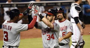 Apr 19, 2016; Miami, FL, USA; Washington Nationals right fielder Bryce Harper (center) is greeted by Nationals center fielder Michael Taylor (left) after Harper hit a grand slam during the seventh inning against the Miami Marlins at Marlins Park. Mandatory Credit: Steve Mitchell-USA TODAY Sports