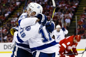 Apr 19, 2016; Detroit, MI, USA; Tampa Bay Lightning left wing Ondrej Palat (18) celebrates his goal during the third period with left wing Jonathan Drouin (27) in game four of the first round of the 2016 Stanley Cup Playoffs against the Detroit Red Wings at Joe Louis Arena. Tampa won 3-2. Mandatory Credit: Rick Osentoski-USA TODAY Sports