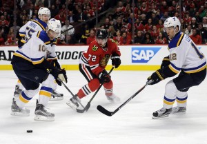 St. Louis Blues right wing Scottie Upshall (10), center Jori Lehtera (12) and Chicago Blackhawks left wing Artemi Panarin (72) go for the puck during the first period in game four of the first round of the 2016 Stanley Cup Playoffs at United Center. Mandatory Credit: David Banks-USA TODAY Sports