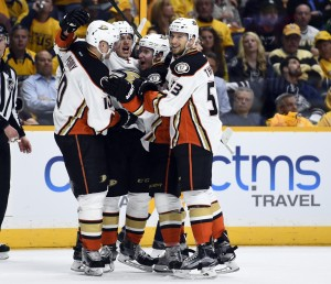 Anaheim Ducks players celebrate after a goal by center Rickard Rakell (67) during the second period against the Nashville Predators in game three of the first round of the 2016 Stanley Cup Playoffs at Bridgestone Arena. Mandatory Credit: Christopher Hanewinckel-USA TODAY Sports