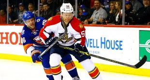 Apr 20, 2016; Brooklyn, NY, USA; Florida Panthers defenseman Michael Matheson (56) and New York Islanders left wing Nikolay Kulemin (86) battle for the puck during the second period of game four of the first round of the 2016 Stanley Cup Playoffs against the Florida Panthers at Barclays Center. Mandatory Credit: Andy Marlin-USA TODAY Sports